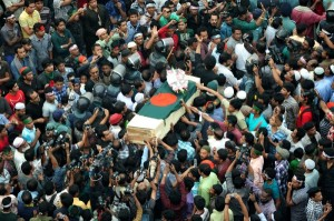 Dhaka, Bangladesh. 16th February 2013 -- Dead body of Rajib Haider reached in a coffin at Shahbagh intersection in Dhaka. -Google Image