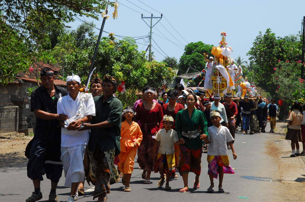 A scene from one funeral procession as part of a daylong mass funeral ceremony