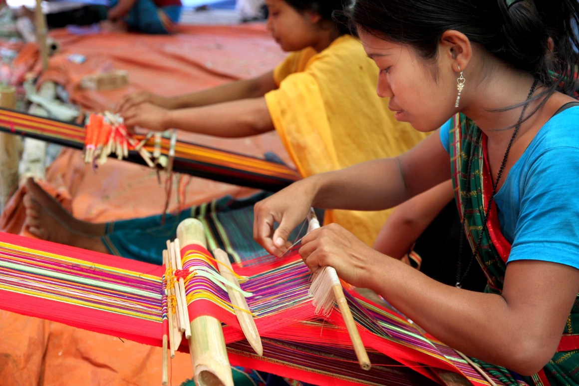 A young girl weaves traditional dress - Photo courtesy of the author