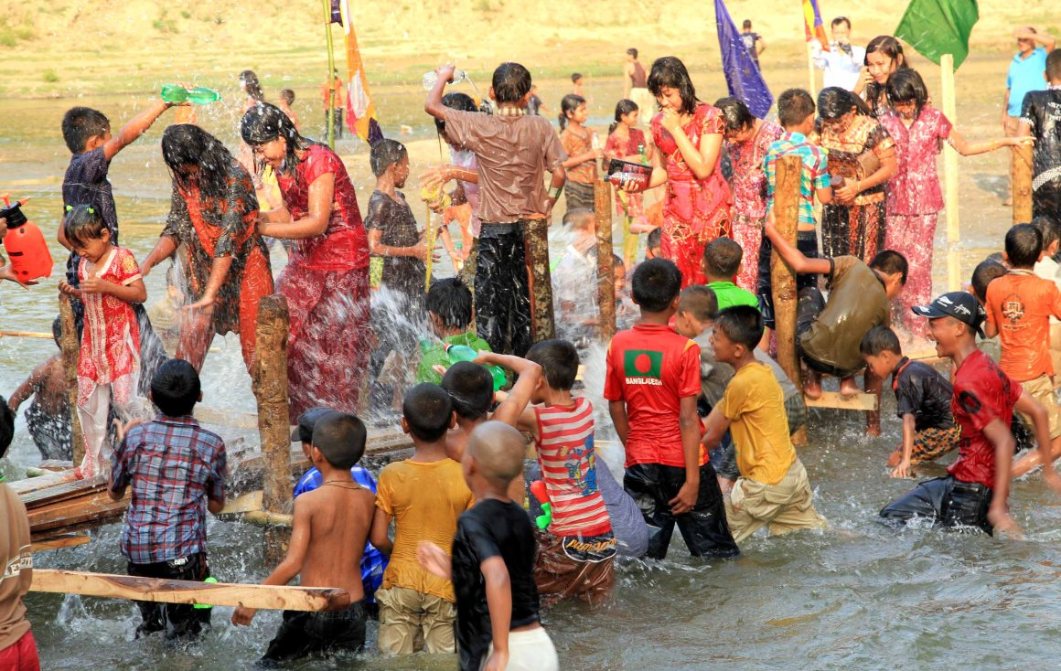 Children and teenagers enjoying a water fight - Photo courtesy of the author