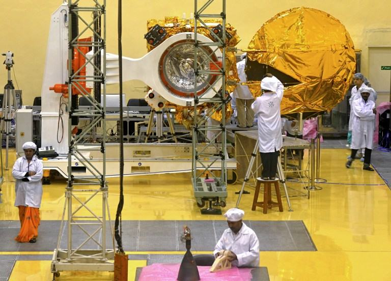 n this file picture taken on September 11, 2013, scientists and engineers work on a Mars Orbiter vehicle at the Indian Space Research Organisation's (ISRO) satellite centre in Bangalore in Bangalore. AFP / Files / Manjunath Kiran (Google Image)