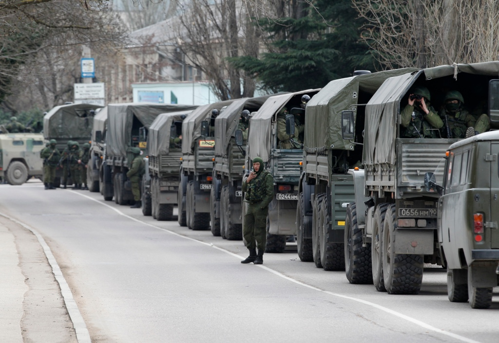 Armed servicemen wait in Russian army vehicles in the Crimean town of Balaclava March 1, 2014. Ukraine accused Russia on Saturday of sending thousands of extra troops to Crimea and placed its military in the area on high alert as the Black Sea peninsula appeared to slip beyond Kiev's control. REUTERS/Baz Ratner (Google Image)