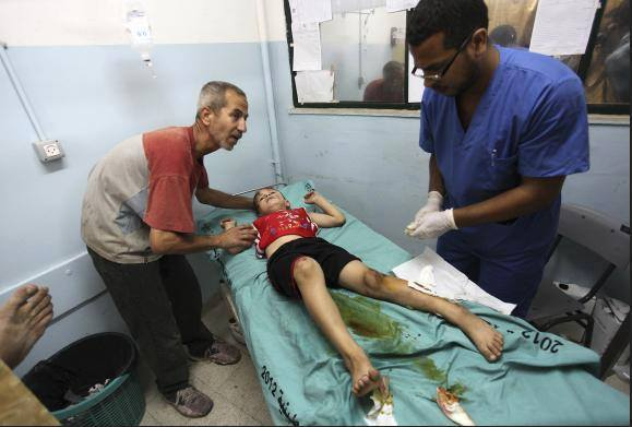 Palestinian boy, who medics said was wounded in Israeli air strikes on a house, is being treated at a hospital in Khan Younis in the southern Gaza Strip  - Photo courtesy of 'Urgent from Gaza' Facebook page