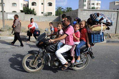 One family fleeing to 'safety' - Photo courtesy of 'Urgent by Gaza' Facebook page