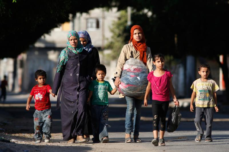A Palestinian family flees their home after receiving a 'warning missile' to evacuate their home - Google Images