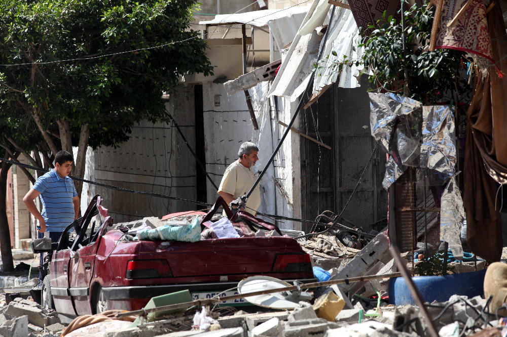 Palestinians in Gaza search the rubble for survivors after an Israeli airstrike - Google Images