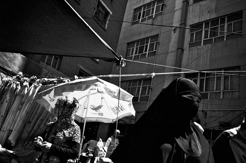 A veiled Muslim Uyghar woman in Xinjiang China: Photo - Brett Elmer