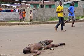 In Monrovia, the capital of Liberia, the health system is near exhaustion. A man lies dead in the street, suspected of dying from Ebola.