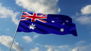 stock-footage-australian-flag-waving-against-time-lapse-clouds-background